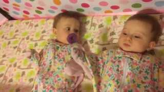Baby girl steals pacifier from twin sister