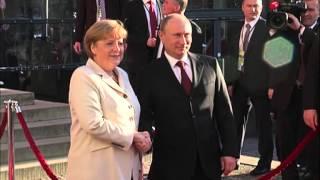 Vladimir Putin Meets Angela Merkel Chancellor of Germany