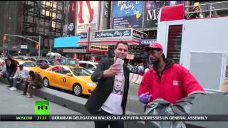 At a protest against Russia, New Yorkers react to RT reporter's Putin shirt