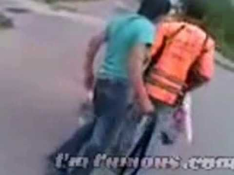Bully trying to attack street cleaner with belt gets owned