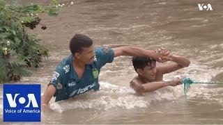 Honduran Migrants Attempt to Cross Border River with El Salvador
