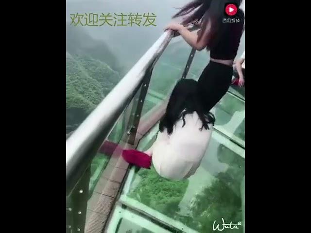 dangerous glass bridge in China .