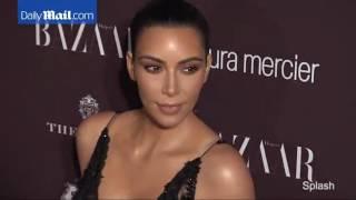 Kim Kardashian wears a lacy black dress to the Harper's party