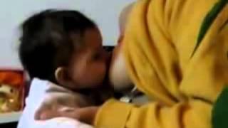 Breastfeeding baby her mother