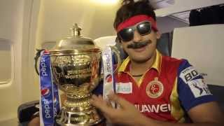Mr. Nags grabs the trophy for RCB – literally!