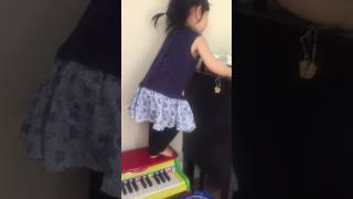 Josie Using Her Feet To Play Toy Organ - 5/20/2017