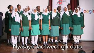 Matuga School singing the Kenyan National Anthem in Dholuo