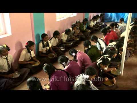 Primary school children receive midday meal in Karnataka