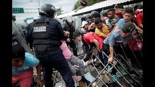 Caravan of migrants held back at Mexico-Guatemala border