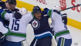 Dustin Byfuglien Takes on Two Canucks