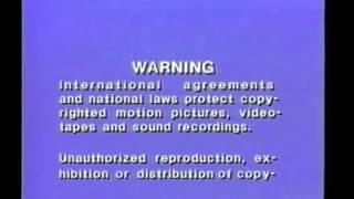 FBI Warning (WB Version) 1985-1995/Warning Screen (OIPC) (WHV Version) English/Français
