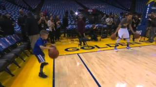 Steph Curry and young fan pregame dribble show