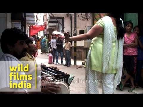 Xxx Mp4 Hijra Dances On A Street In Delhi Places Money Into Her Blouse Indian Transvestites 3gp Sex