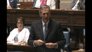 Premier Brian Pallister answers a question on affordability