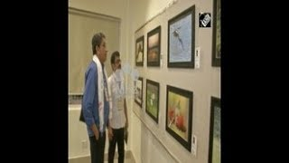 India News - Wildlife photography exhibition held in India's eastern Siliguri city