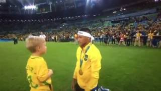 Neymar celebrating with his son Davi Lucca after winning the Final vs  Germany.