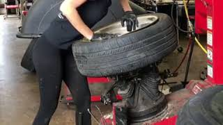 girl is changing tire