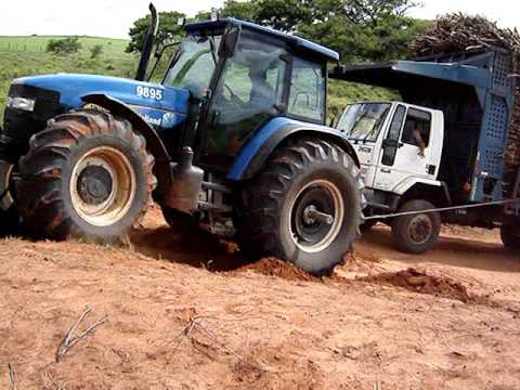 New Holland puxando Ford Cargo 2631