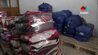 """سوق الملابس المستعملة في تونس """" الفريب """""""