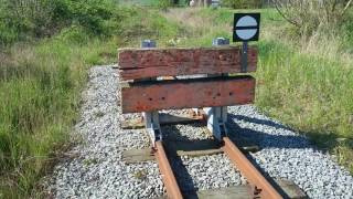 Prellbock in Reppenhagen. Schmalspurbahn Lütt