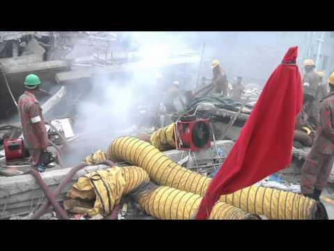 Rescue workers in Bangladesh search Rana Plaze rubble