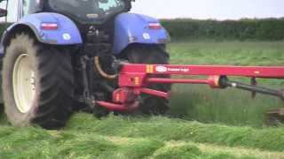 Mowing Silage  at the Grass with New Holland T6080 & Taarups Mowers