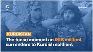 The tense moment an ISIS militant surrenders to Kurdish soldiers