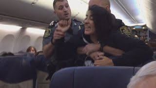Woman Removed From Plane After Claiming She Was Allergic To Dogs On Board
