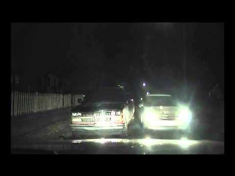 Woman hits police car