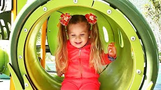 Little girl Diana have fun playing on the Outdoor playground, Kids video