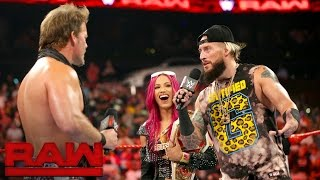 Sasha Banks and Enzo Amore are confronted by a couple of