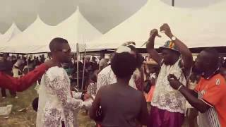 Dr.Flezzy & Okpan Arhibo Show off Cash at his Grandmother burial ceremony