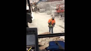 Mobile crane apprentice attempting to fix a grease gun