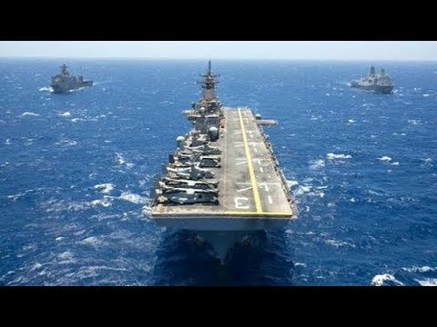 Two lranIan fast boats approached the US Wasp class amphibious assault ship