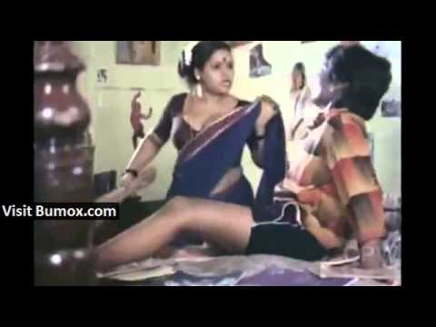 Indian servant purposely adjusting saree to show navel