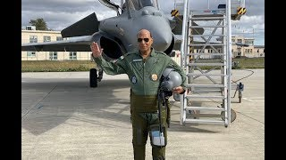 Breaking News: Rajnath Singh flies in Rafale fighter jet in France