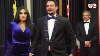 أخبار اليوم | قبلة أحمد الفيشاوي لزوجته في مهرجان القاهرة السينمائي