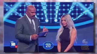 Kim Kardashian and Kanye West play