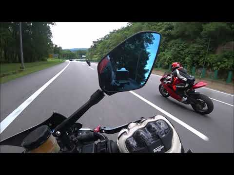 A female BMW S1000RR rider chases 2 Dudes on a Panigale