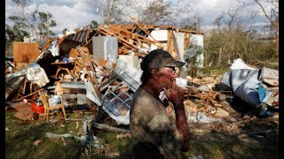 Amidst dark and debris, relief operations seek to sustain hurricane survivors