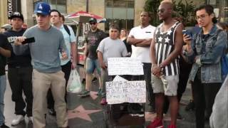 Homeless woman attacked by mob for defending Trump's Hollywood star.