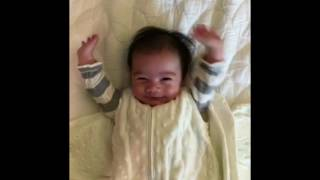 Cute baby throws his hands up after being unswaddled - KPtheBaby