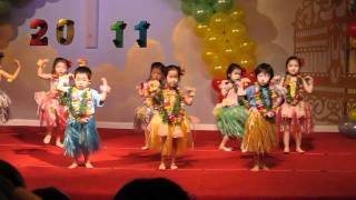 Sarah hula dances at her pre-school's graduation ceremony