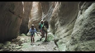 Girls On Cave Hike Stock Video