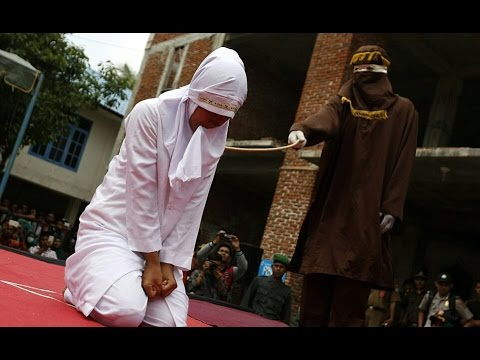 Xxx Mp4 Indonesian Woman Sobs As She Is Caned In Public For Having Sex Outside Marriage 3gp Sex