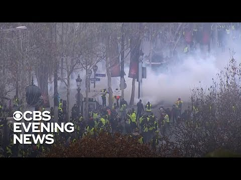 Xxx Mp4 French Police Fire Tear Gas At Protesters In Paris 3gp Sex