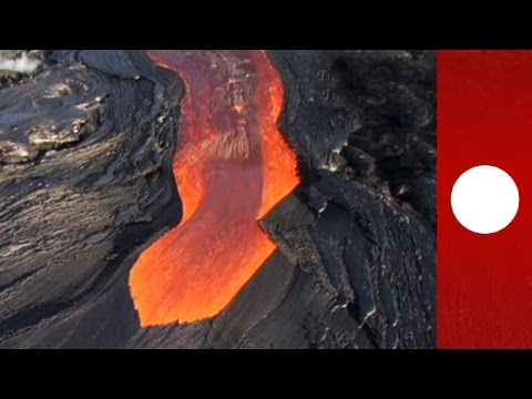 Molten lava streams down Hawaii s Kilauea volcano helicopter footage