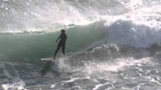 Surfer Drops in on Bodyboarder