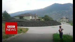 Mudslide erupts in Swiss village - BBC News