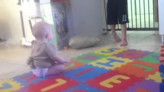 Enjoying her floor mat from Grammy and Granpa B gard